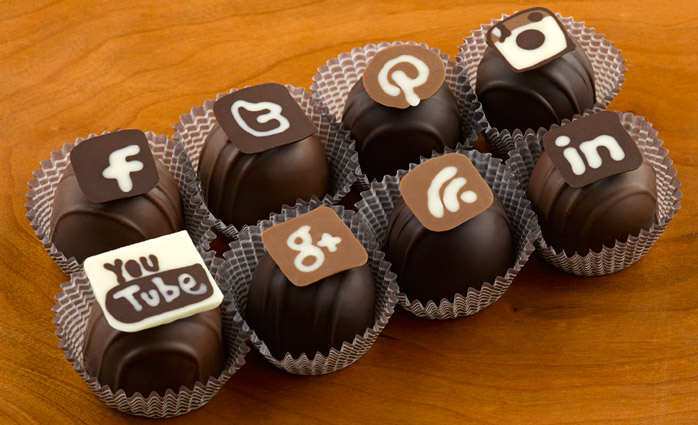 Connect with us...social icons made out of chocolate on top of chocolate truffles